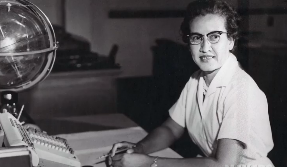 "Katherine Johnson at her desk at Langley with a ""celestial training device."" Credit: NASA"