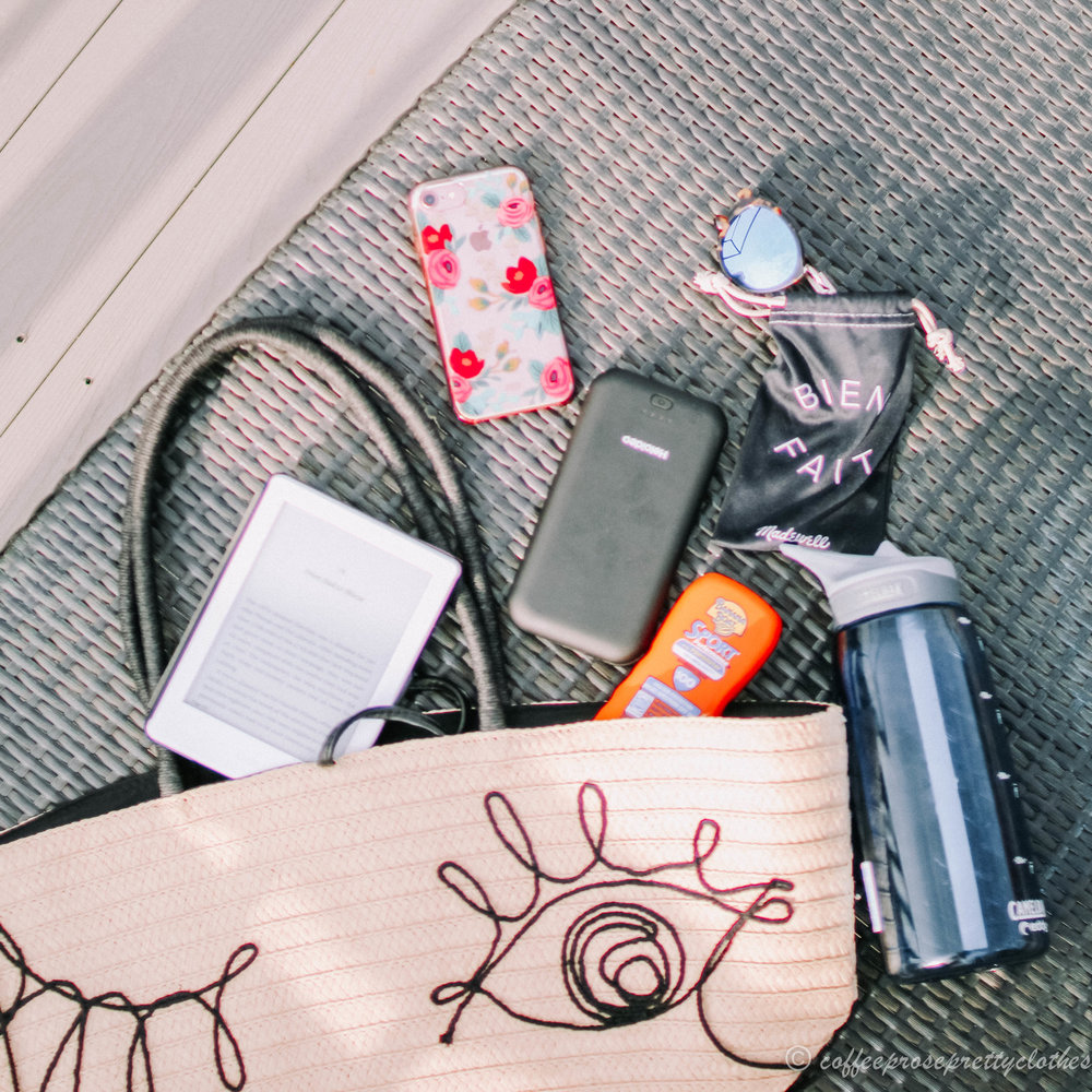 H&M winking tote, Camelbak Edy water bottle, Madewell sunglasses, Amazon Kindle, Banana Boat sunscreen, Rifle Paper Co phone case, Heloideo phone charger