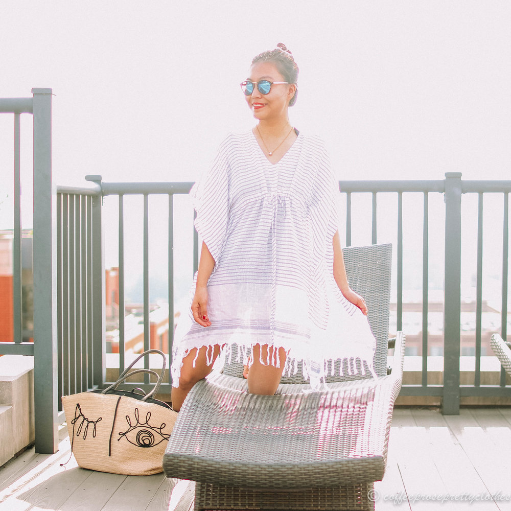 ASOS Southbeach swimsuit, ASOS coverup, Madewell sunglasses, H&M straw tote with winking eyes
