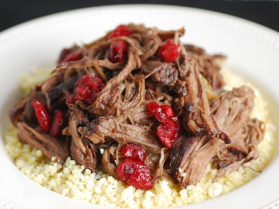 Cranberry Ropa Vieja - Season flank steak, and sear the steaks in a Dutch oven. Place steaks in a pot, and add cranberries, cranberry juice, onions, and garlic. Also add cinnamon sticks, oregano, bay leaf, brown sugar, and red wine. Let beef braise on the lowest setting for 3 hours, or until meat is tender. Shred with a fork, puree sauce, and enjoy!Get the Recipe