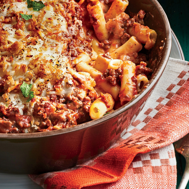 Greek Baked Ziti - The perfect dish for chilly evenings! This traditional recipe infuses sautéed ground beef and tomato sauce. Top beef with gooey parmesan cheese, melted mozzarella cheese, breadcrumbs, and spices. Make ahead, freeze, and pull out for a relaxed weeknight dinner!Get the Recipe