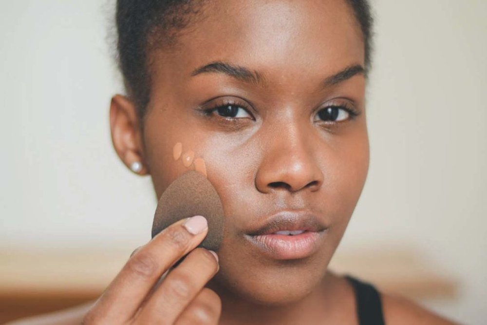 blogger wearing glossier skin tint