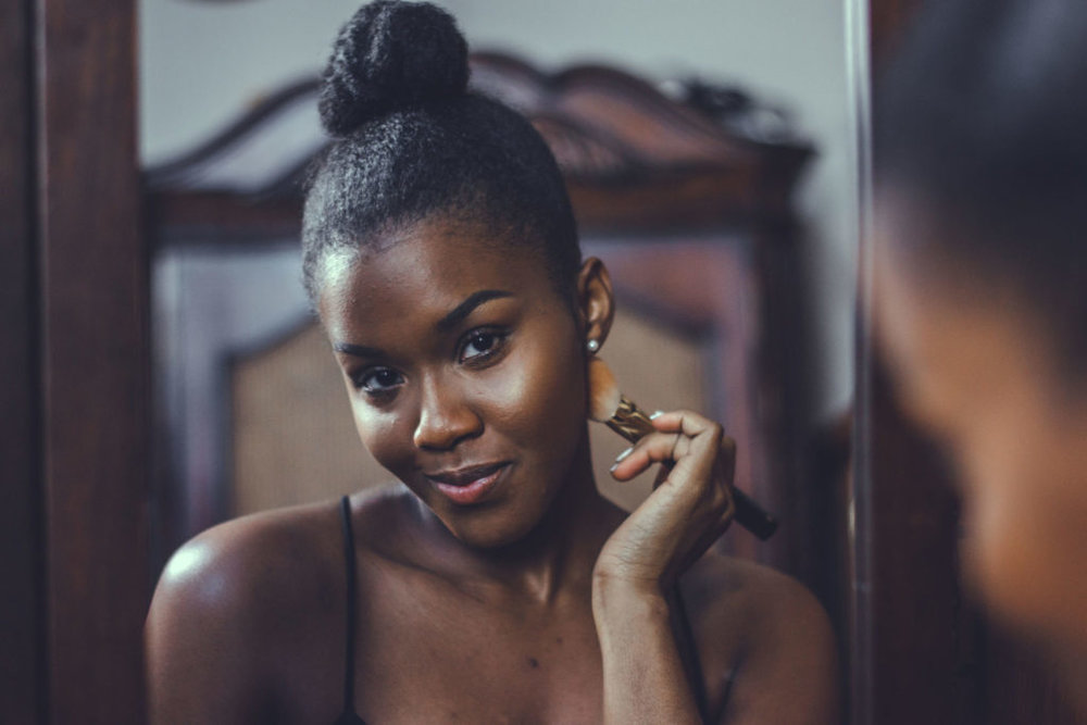how to shop foundation women of color makeup in a mirror