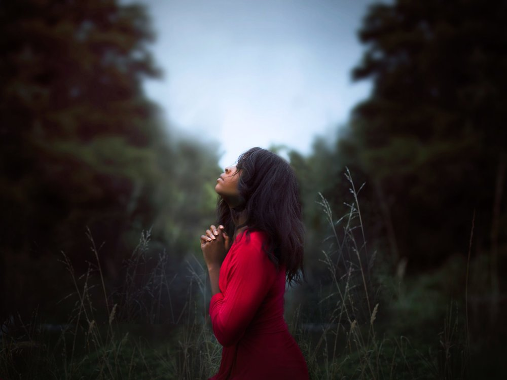 girl-praying-in-the-woods.jpg