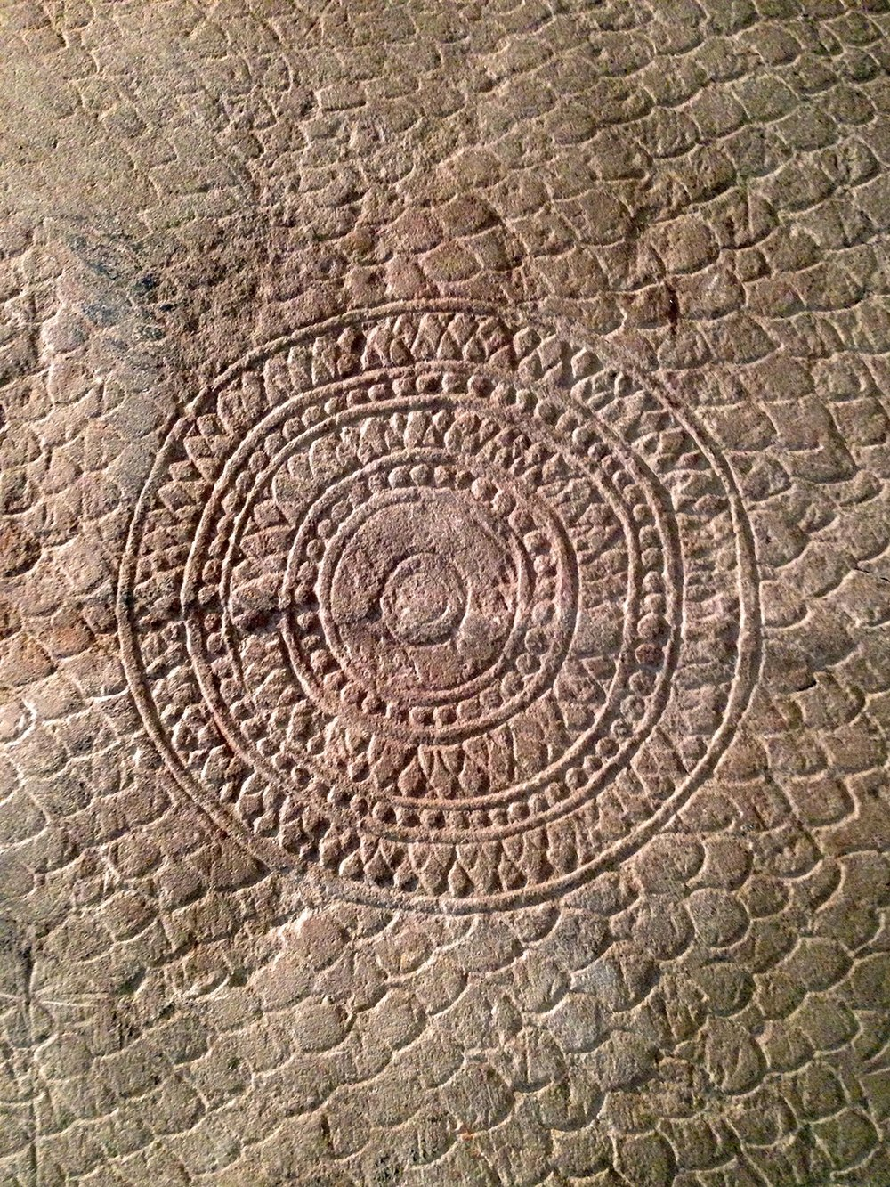 Concentric circles on back of Naga sculpture.