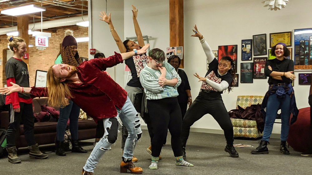 """Urban Bush Women artists Ross Daniel, Courtney Cook, and Tendayi Kuumba, from left, with Columbia College Chicago students for a """"Hair Party"""" at The Loft, hosted by the Black Student Union. Photo by Zachary Whittenburg."""
