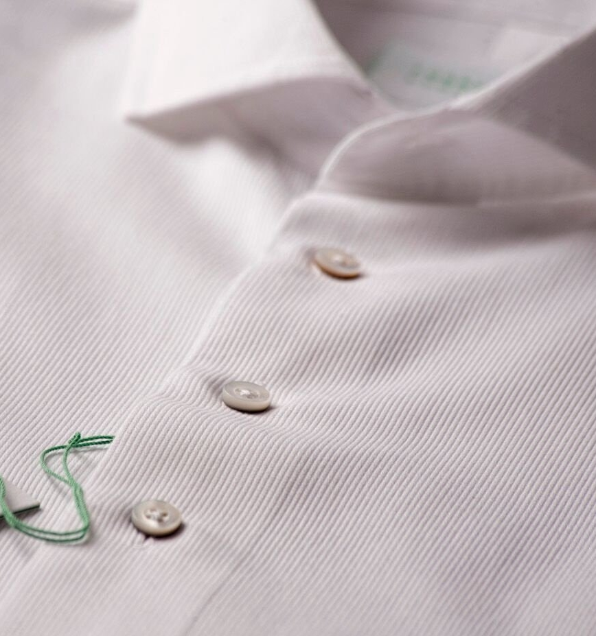"FORREST LENNARD  Makers of luxury, casual, white shirts in both button down and spread collar models. We source globally to find the finest 100% cotton and 100% linen fabrics.  We pay attention to the details like a split mitered yoke, exaggerated curved sleeve cuffs, mother of pearl buttons, an 8 button front, and more.  In the end, what you'll really fall in love with is the fabric and the ""feel"".  Our shirts form the foundation of a timeless and distinctive look, one that ensures a sense of style no matter what the occasion."