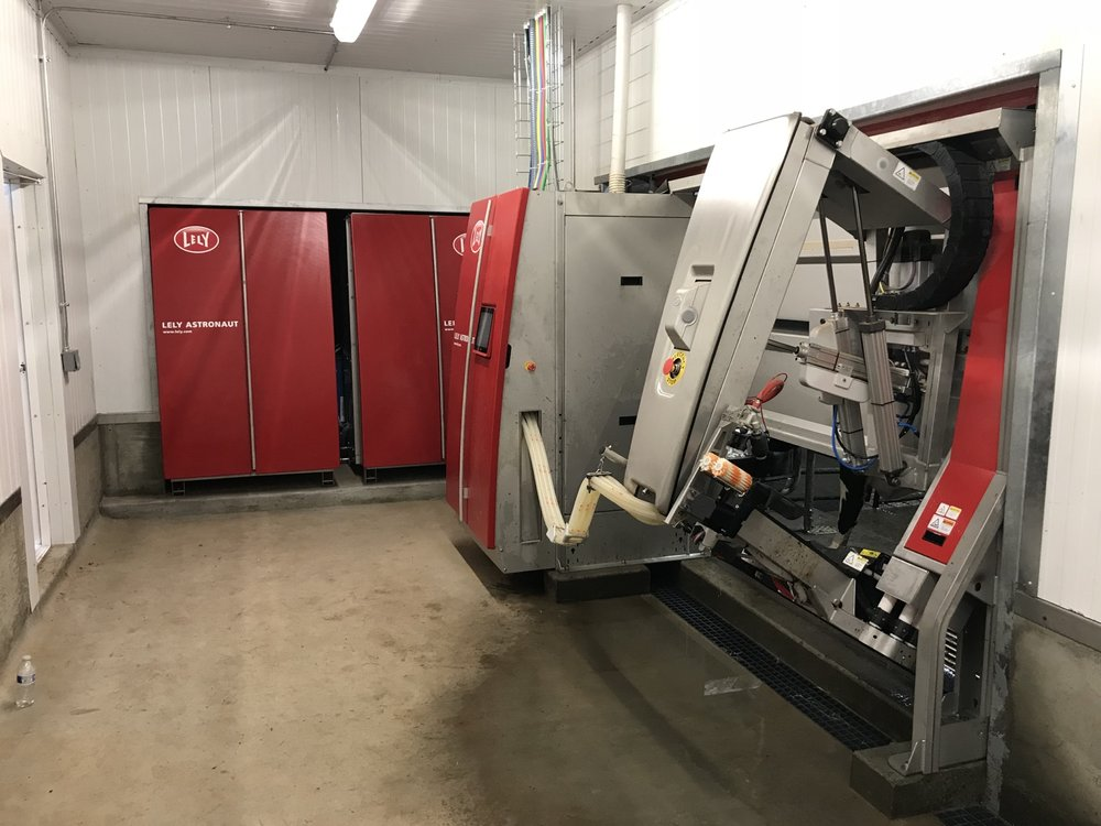 Lely Robot Room with arm extended.jpg