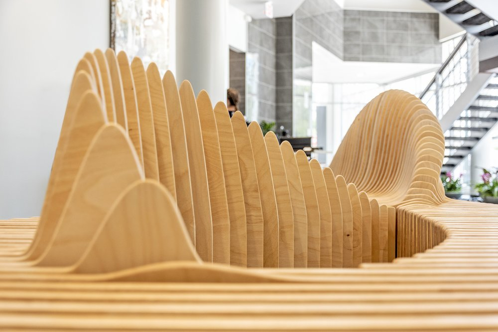sabal palm bank bench 8 handmade parametric furniture cnc router sectioned flowing wooden decorative postmodern organic geometric plywood airport museum public bench terraform design.jpg