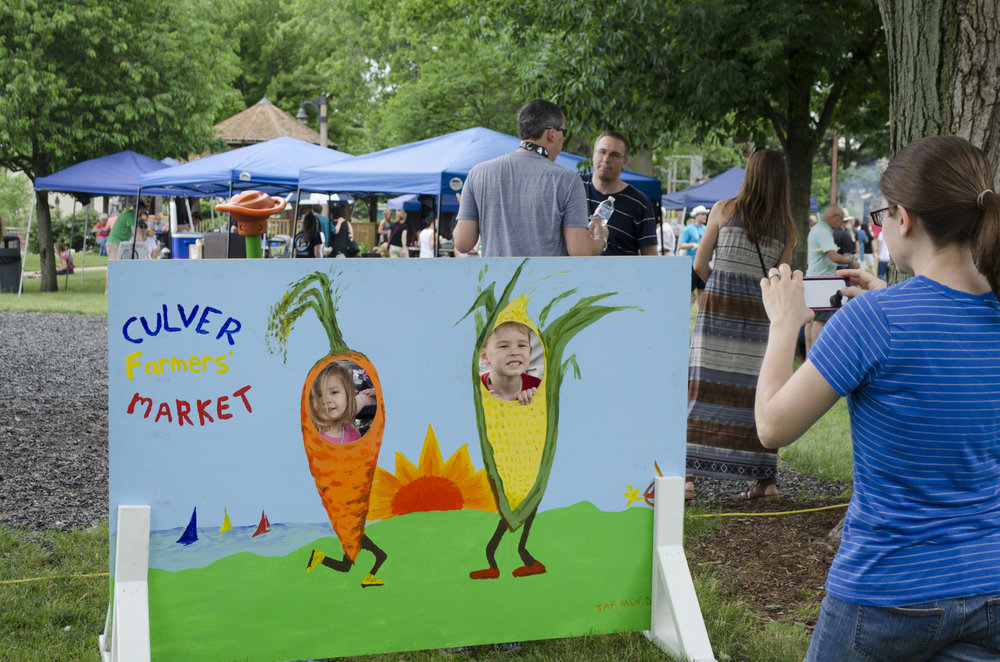 Children pose in the Culver Farmers' Market sign. The Culver Farmers' Market took place alongside Taste of Culver with local produce, crafts and more available.