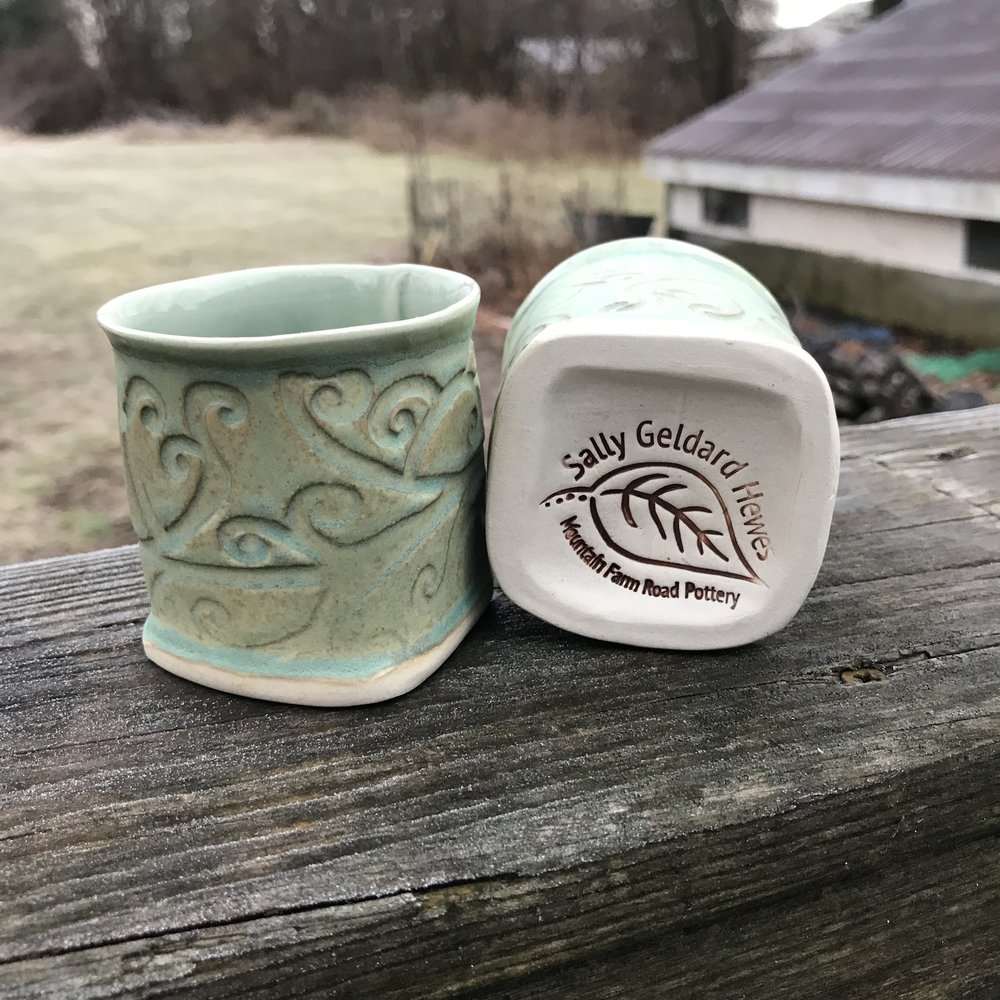 - Sally's logo stamped onto the bottom of a sweet pair of espresso cups. Visit Mountain Farm Road Pottery HERE.