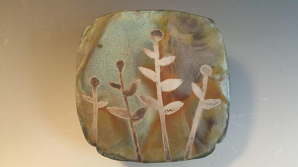 """Untitled"" 2018, raku-fired stoneware with paper resist design"