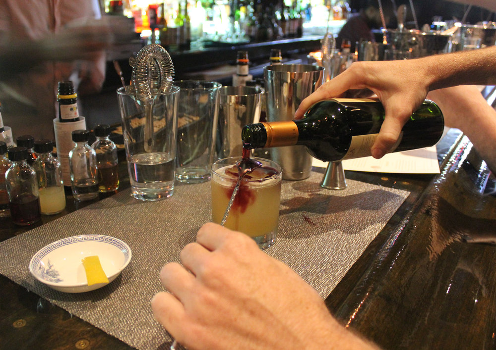 Topping off our New York Sour with malbec. Steady hands, steady hands.
