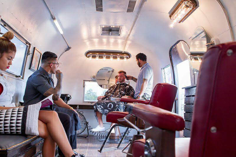 The final product of En Root Mobile Barbershop with customers.
