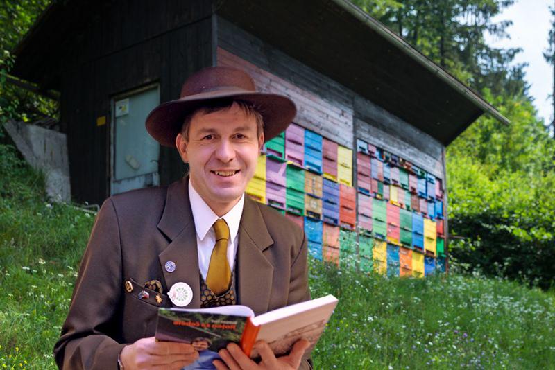 Boštjan Noč, in formal Slovenian beekeeper attire, outside one of his bee houses in Solo, Slovenia.