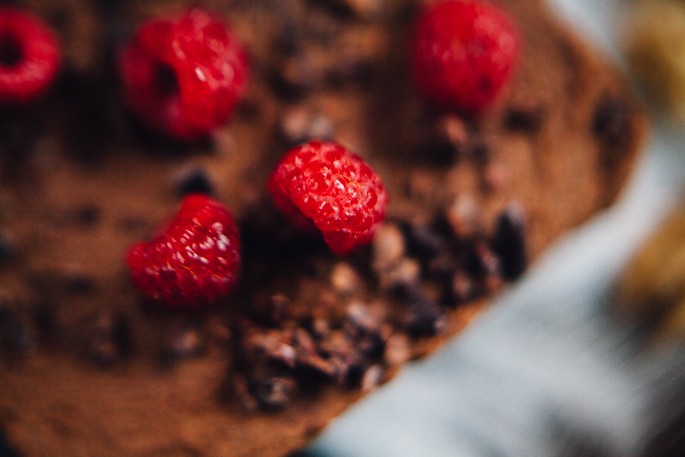 raw chocolate walnut mousse cake topped with raspberries | vegan and gluten free recipe via will frolic for food