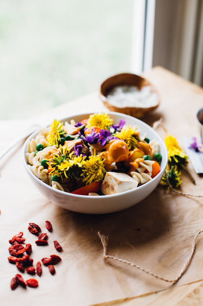 spring pea and wild flower pasta salad with goji tahini sauce! vegan & gluten free recipe via will frolic for food