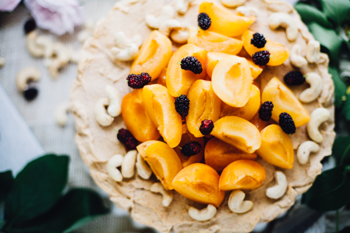 almost raw apricot bourbon cheesecake with a sunflower seed crust | vegan & gluten free recipe via will frolic for food