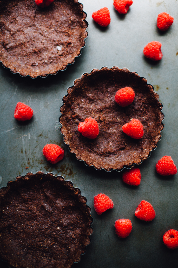 rasperry rhubarb yogurt tart in almond cocoa crusts | an easy, no-bake recipe that's low glycemic, gluten free and full of protein and good fats | recipe via will frolic for food