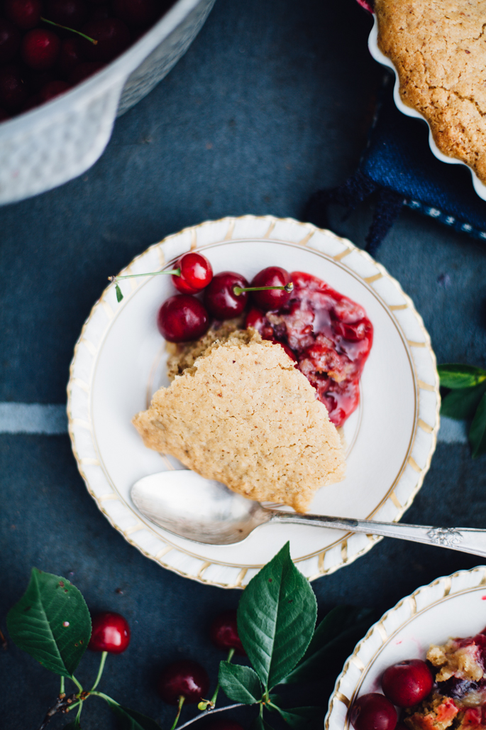 sour cherry spoon cake! made with natural sweeteners, coconut oil, and wheat free flours, it's a game changer! And it's SO easy! vegan & gluten free recipe via will frolic for food