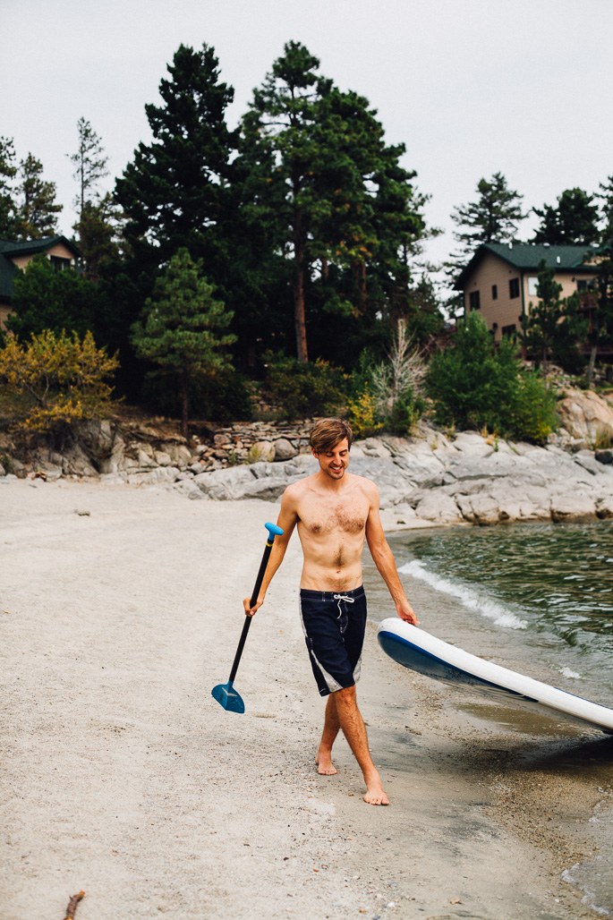 paddle boarding on a lake in montana | willfrolicforfood.com