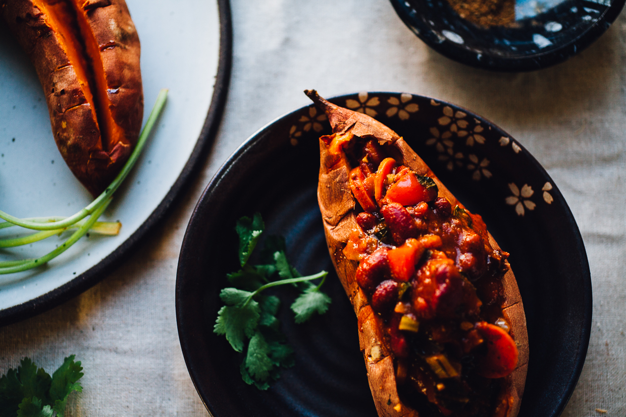 moroccan chili stuffed sweet potatoes with avocado cream | recipe via willfrolicforfood.com