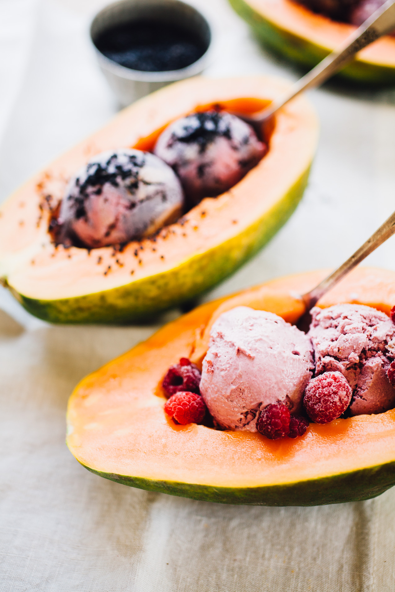 nice cream papaya boats! coconut-cashew raspberry and blueberry ice cream + papaya = bliss! recipe via willfrolicforfood.com
