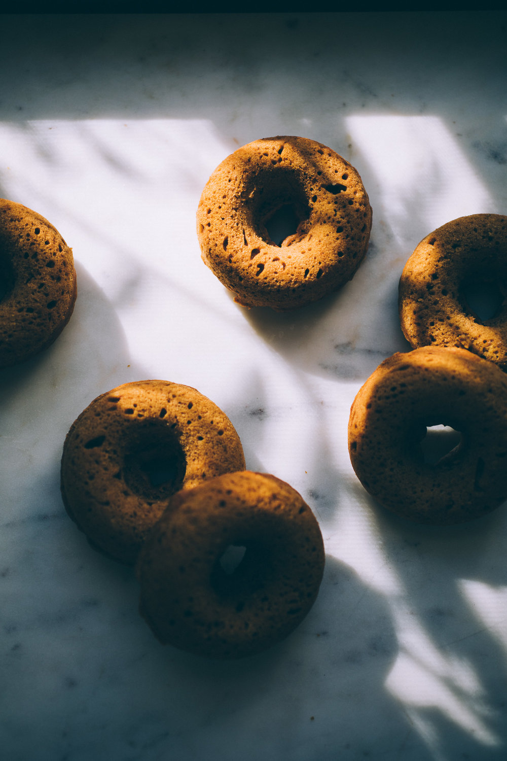 Baked Vegan Pumpkin Cider Doughnuts with Maple Cinnamon Cashew Frosting | get the recipe via willfrolicforfood.com
