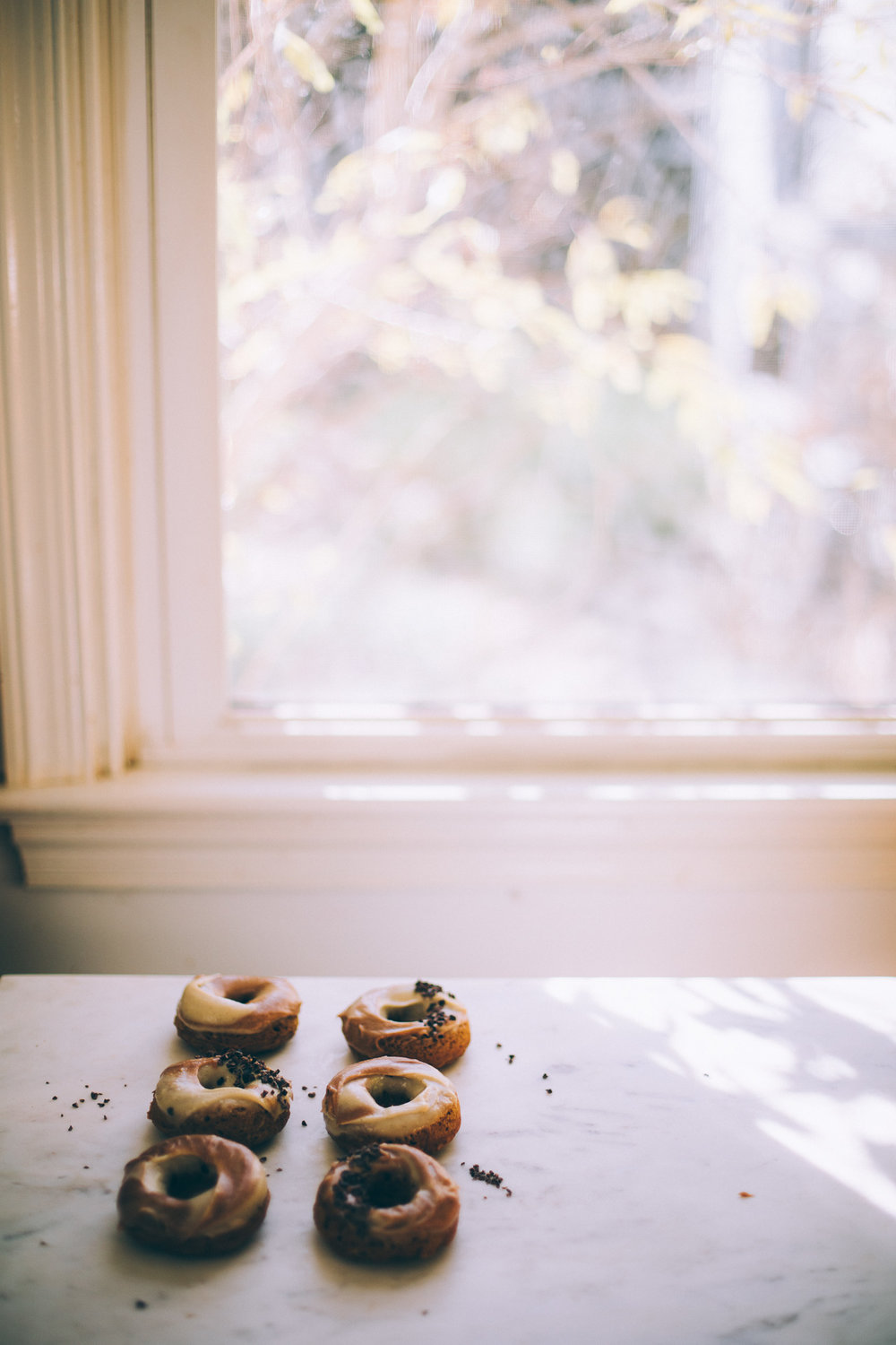 Healthy Baked Vegan Doughnuts with Maple Cinnamon Cashew Frosting | recipe via willfrolicforfood.com