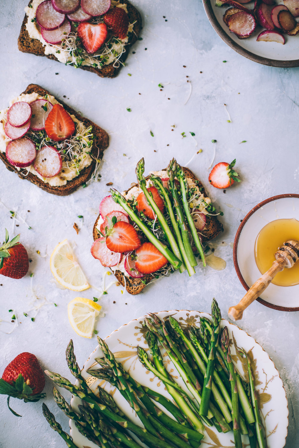 ghee sauteed radish toasts with almond ricotta, strawberries, asparagus, honey. east appetizer ideas. vegetarian easter. dairy free appetizers.