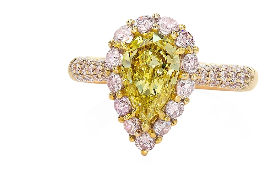 Yellow and Pink Diamond Engagement Ring - A contrast of colors that is absolutely stunning. This colorful engagement ring features a fancy intense yellow pear shape diamond in a dazzling pink diamond surround. Mounted in polished 18k rose gold.