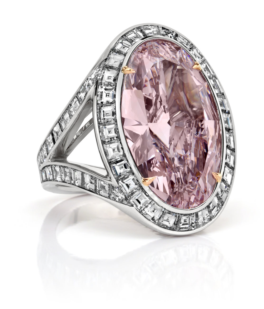 FANCY PINK DIAMOND HALO ENGAGEMENT RING   Features a fancy pink diamond center stone surrounded by a row of asscher cut white diamonds. Double shank setting accented with asscher cut diamonds as well. A unique and bold piece!