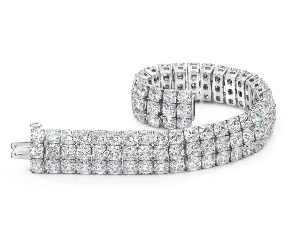 CUSHION CUT DIAMOND THREE ROW TENNIS BRACELET   Bask in the spotlight with this very stunning diamond bracelet. Features brilliant cushion cut diamonds set in a unique three row setting. Weight of the diamonds is 44.30 carats total.
