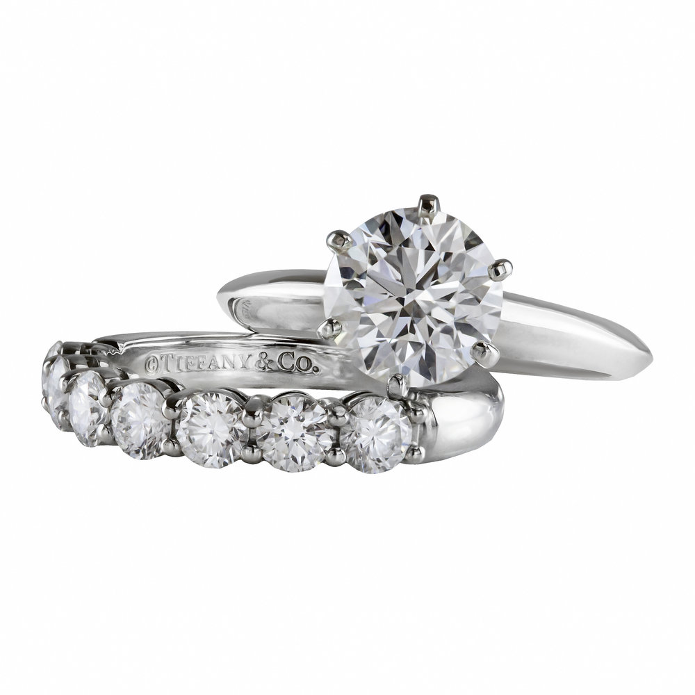 Classic Tiffany & Co. Solitaire Engagement Ring  paired with a matching Tiffany & Co. Seven Stone Diamond Wedding Band