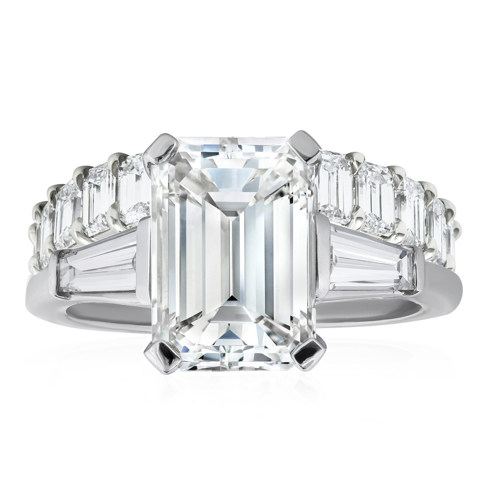 Emerald cut diamond three-stone engagement ring  paired with an  emerald cut diamond eternity wedding band