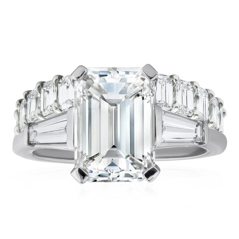 Emerald cut diamond three-stone engagement ring  paired with an  emerald cut diamond eternity wedding band