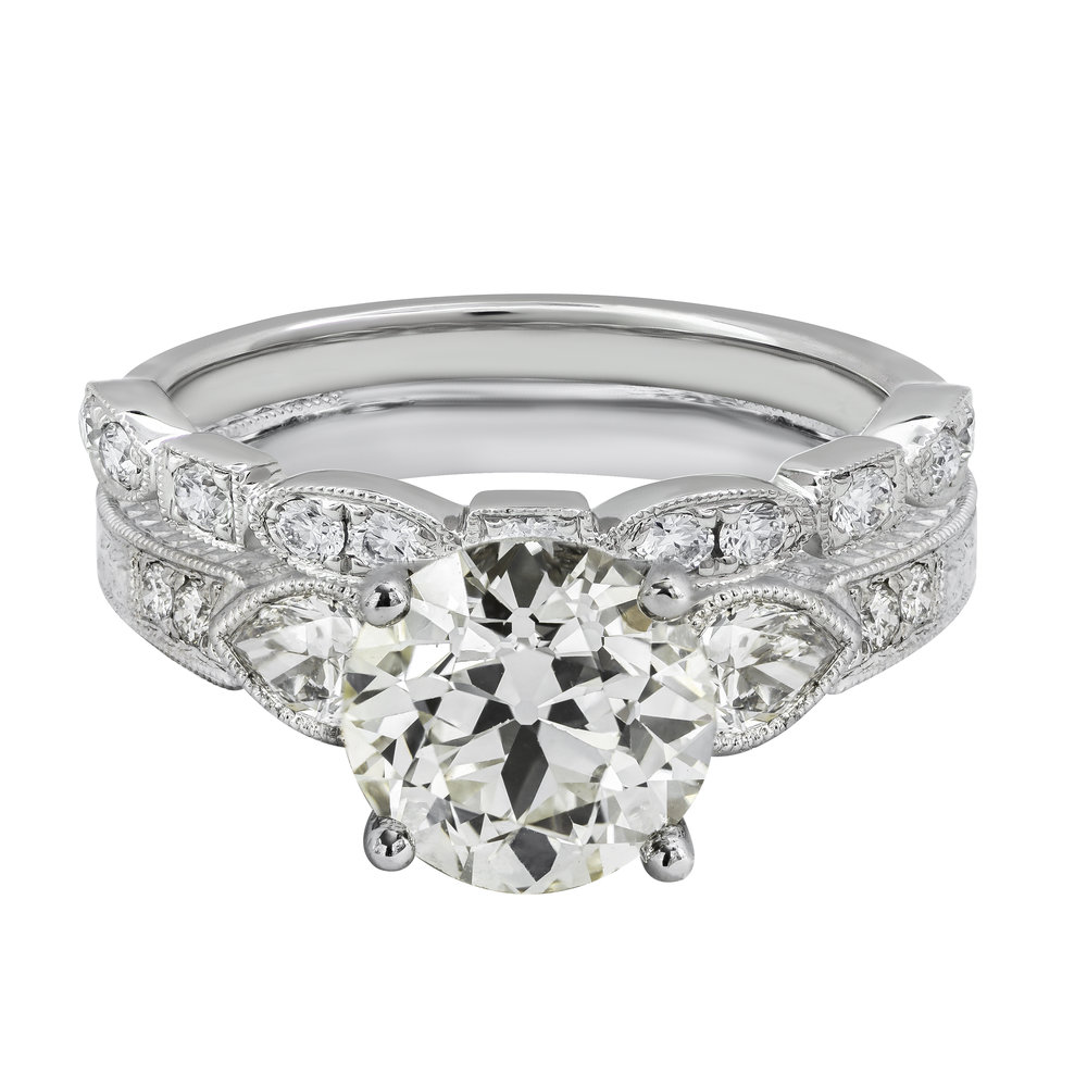An antique old european cut diamond engagement ring matched with an  antique style diamond wedding band
