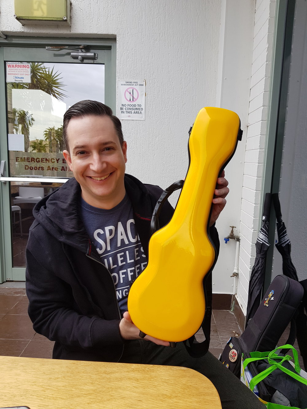 Cameron Murray with the funkiest hard ukulele case I've seen! And it holds his tiny vintage Martin uke very nicely.