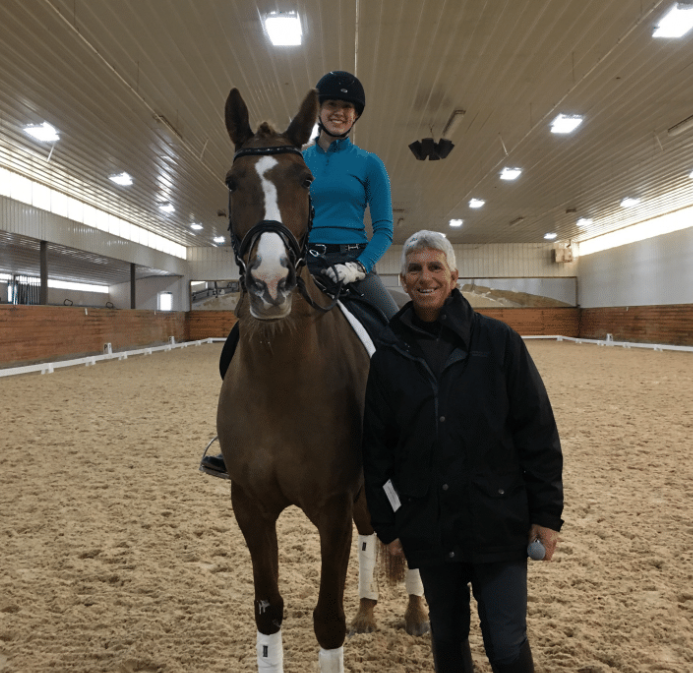 Madelyn Taray riding Elzarma with George Williams