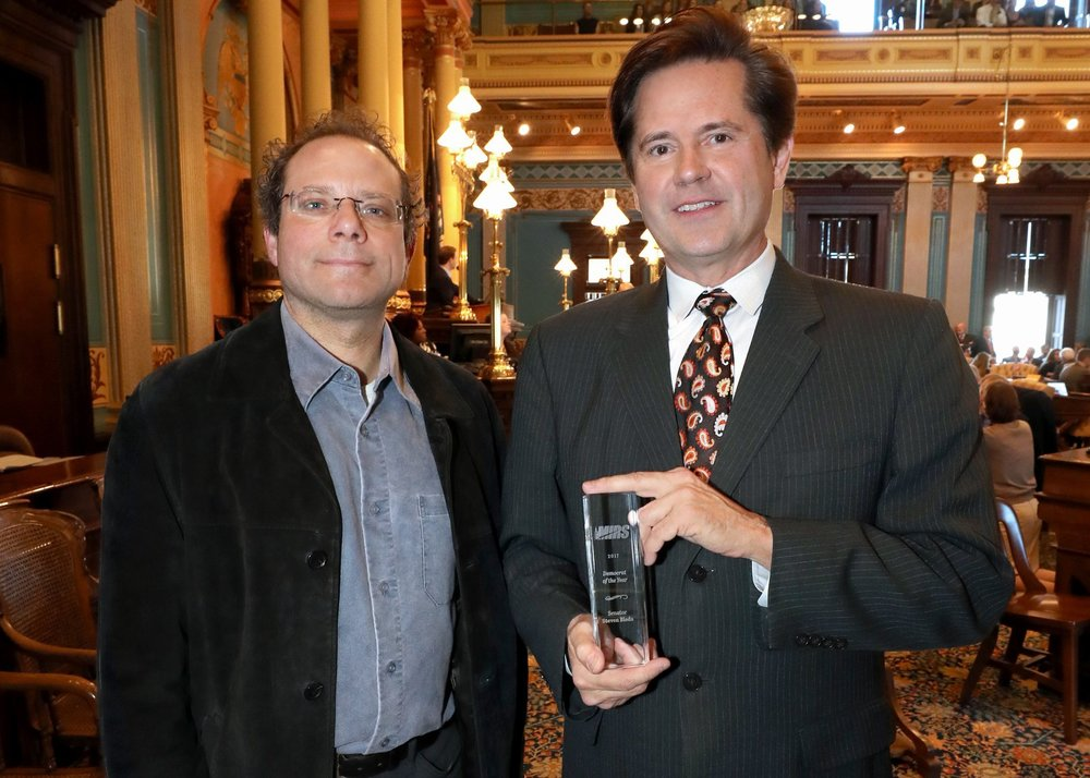 "State Sen. Steve Bieda (D-Warren) accepting the MIRS 2017 ""Michigan Democrat of the Year"" award from Editor Kyle Melinn."