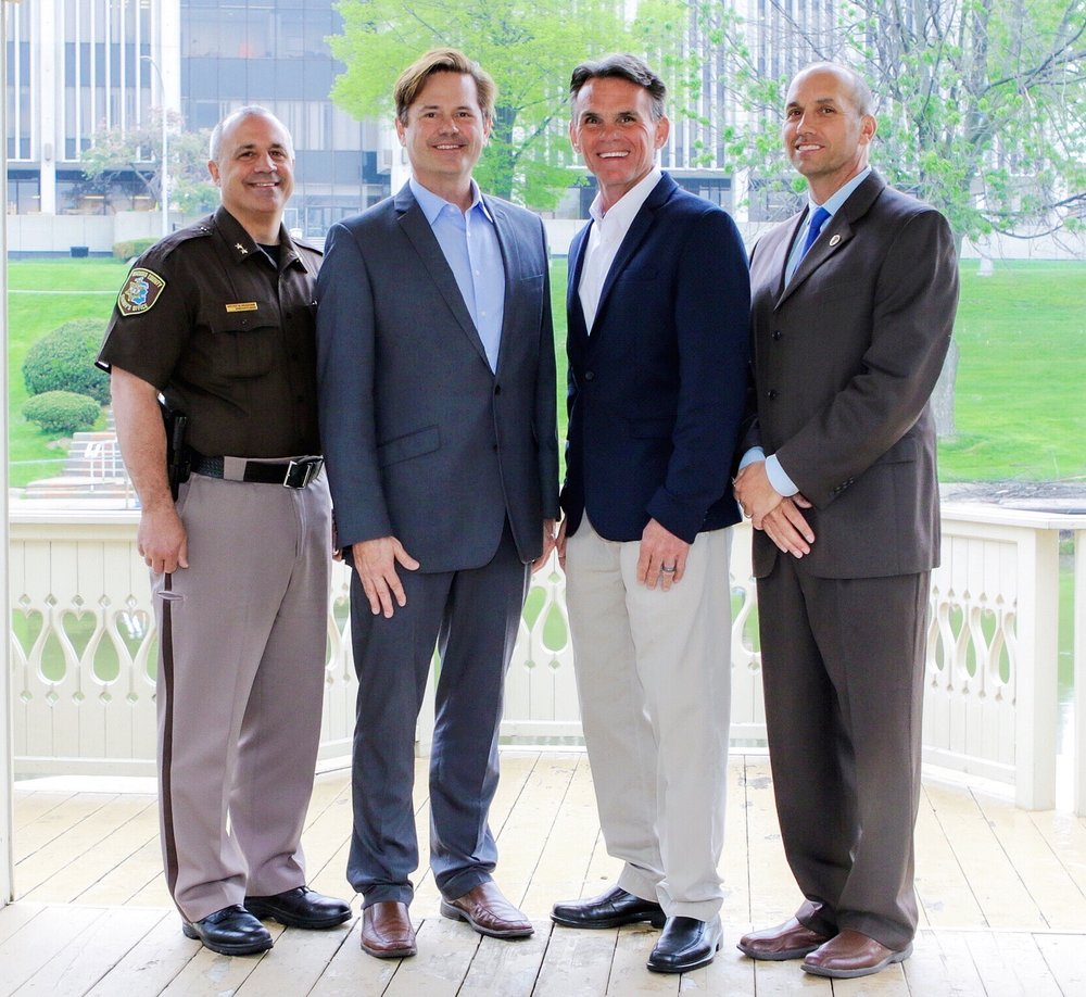 From left to right: Macomb County Sheriff Anthony Wickersham, Macomb County Executive Mark Hackel, State Senator Steve Bieda and Macomb County Prosecutor Eric Smith.
