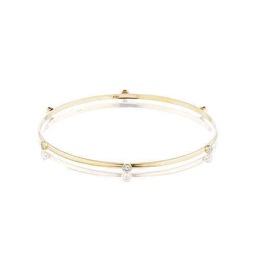 BEZEL BANGLE SKINNY - Six 3mm bezel diamonds surround circular sustainability on the skinny bangle - 14K reclaimed solid gold for strength and wearability.$1,225