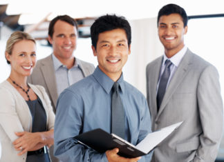 43294-happy-business-team-in-office-portrait-man-asian-324x235.jpg