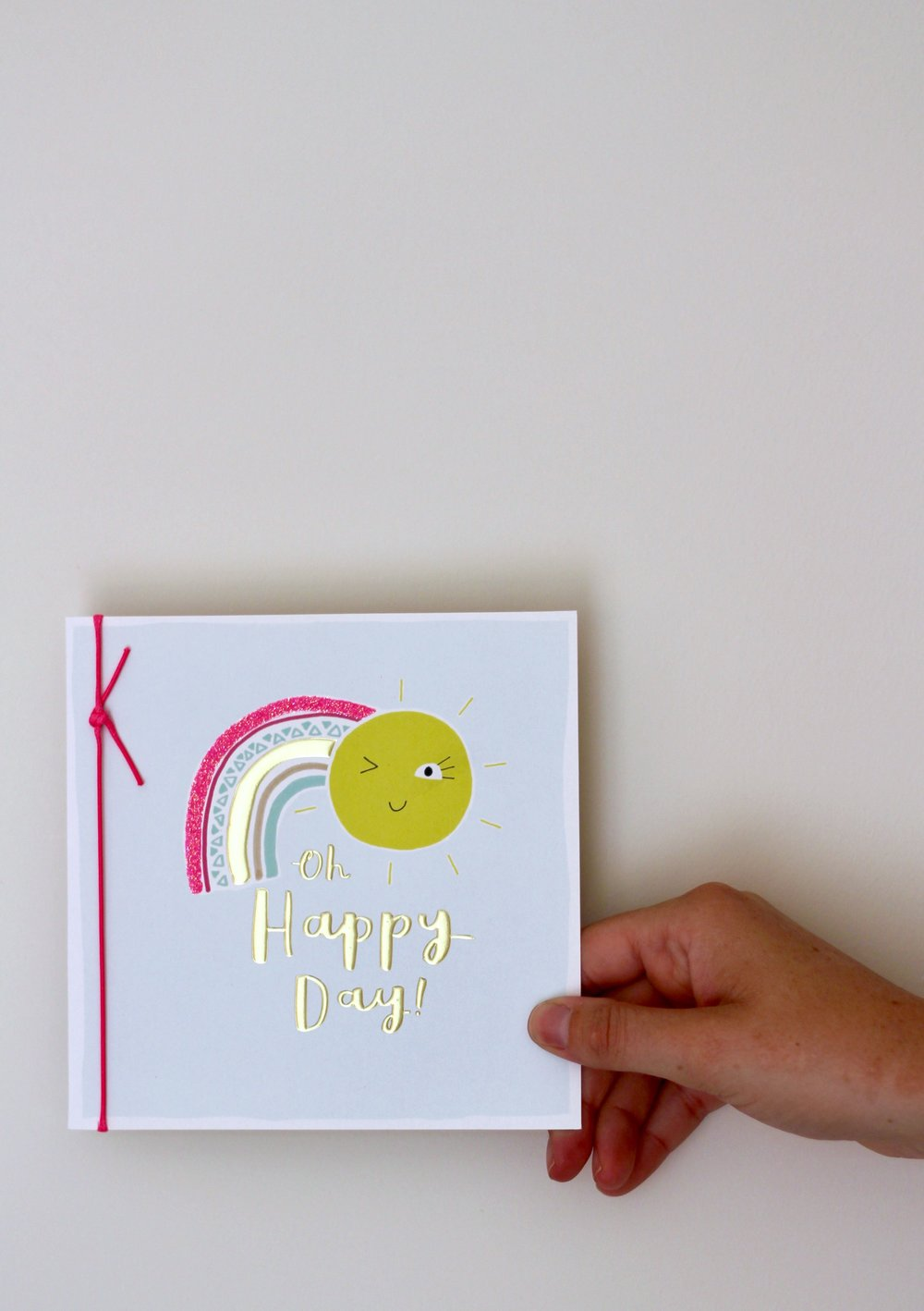 Oh Happy Day card being held against the wall