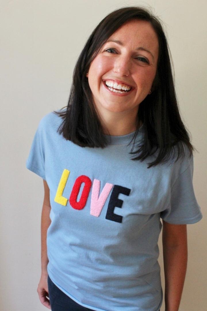 Smiling brunette in love t-shirt