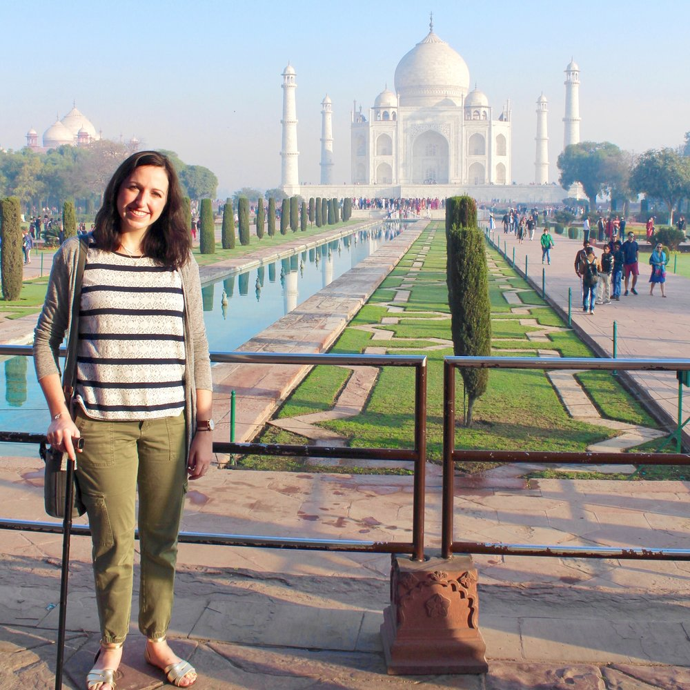 Brunette with walking stick at Taj Mahal | Ten things that have shaped me over ten years | Joanne Becker | Be Stubborn | Coaching | small business, creative coaching, resources, content creator