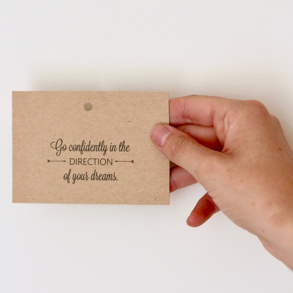 """Quote on brown card: """"Go confidently in the direction of your dreams"""" 