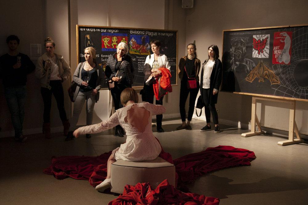 Performance by Hanna Zubkova, overlooking Lado Darakhvelidze's The Walking History Corridor during PLOV #2 ARTxFOODxCINEMA. Taken on 19 June 2018 at Studio/K, Amsterdam © Juan Aguirre Fernández-Bravo
