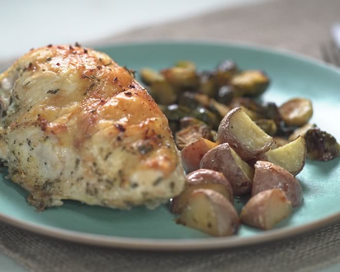 Sheet-Pan Dinner - The division dietitian has chosen this a-peeling Sheet-Pan Dinner recipe: Lemon-Garlic Chicken Breast with Roasted Rosemary Potatoes and Brussels Sprouts from Ellie Krieger.
