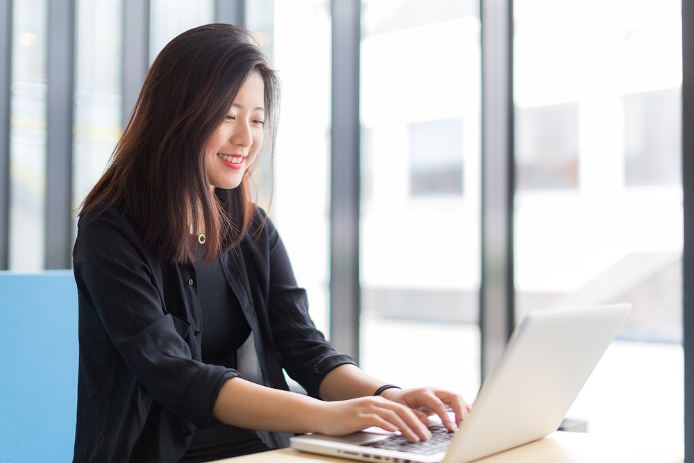 Asian-college-student-sitting-with-a-laptop-478949096_5760x3840.jpeg
